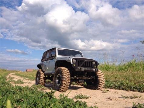 rc jeep wrangler unlimited rc jeep wrangler unlimited in mud axial scx10