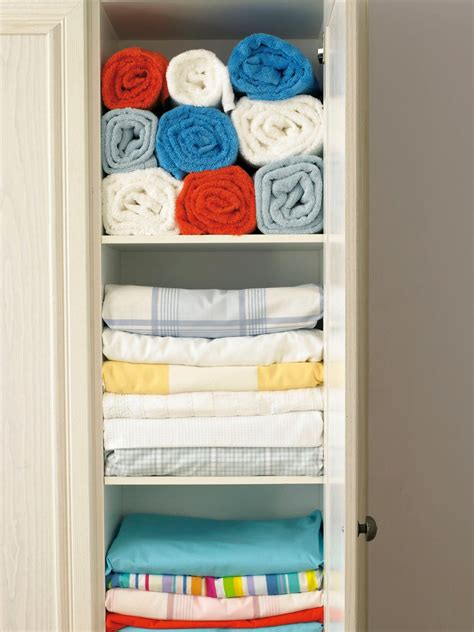 Organizing Towels In Closet by Decluttering The Linen Closet Hgtv