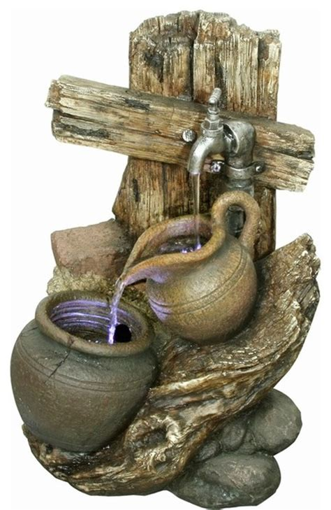 yosemite home decor fountains yosemite home decor faucet with pitcher and pot polyresin