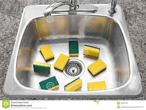 Faucet Sink Kitchen lots of yellow sponges in a clean kitchen sink stock