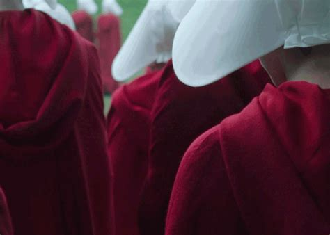 handmaid s texas women gathered dressed as characters from the