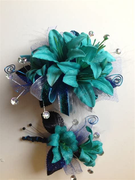 teal corsage teal keepsake prom corsage and matching boutonniere florescence by design flowers