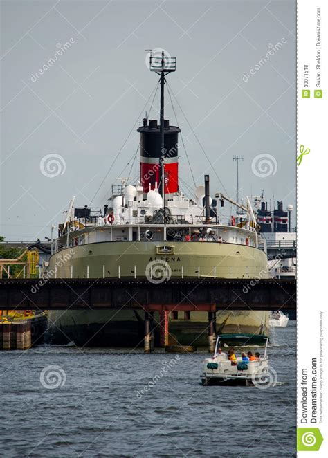 small pontoon boats michigan big ship in the harbor editorial stock photo image of