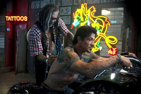 does sylvester stallone have tattoos the expendables shows stallone can still make sort
