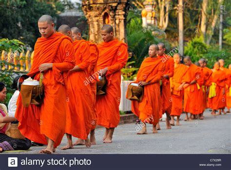 What Lies Beneath The Robes Are Buddhist Monasteries Suitable Places For Children Adele Buddhist Monks Walking With Monk Bowl To Collect Food In