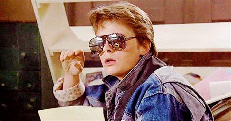 robert zemeckis michael j fox 80s gif find share on giphy