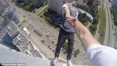 people falling off swings olegcricket swings from a friend s arm as he dangles 40