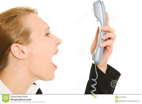 Screaming Phone businesswoman screaming into the phone stock images