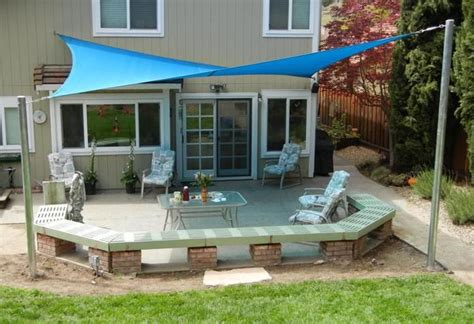 u shaped bench made out of brick sun shade sails create