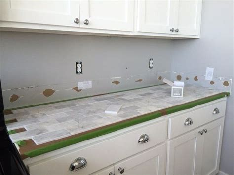 a marble panel backsplash for our diy kitchen the diy mommy diy marble backsplash in the kitchen hometalk