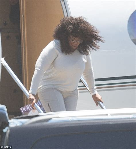 oprah winfrey jet oprah winfrey goes make up free as her curly locks blow in