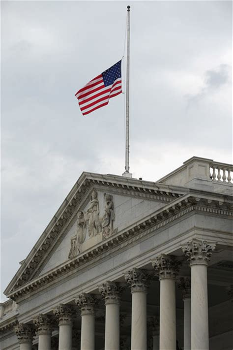 white house and us capitol flags at half staff in honor of