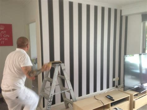 black and white feature wallpaper black and white striped wallpaper used by bec and george