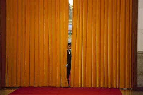 through the curtain free public domain image peeking through a curtain