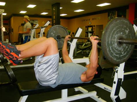 feet up bench press ignore the big strong guy and guarantee failure get