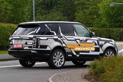 new land rover defender spy shots range rover spy shots reveal body of new luxury suv