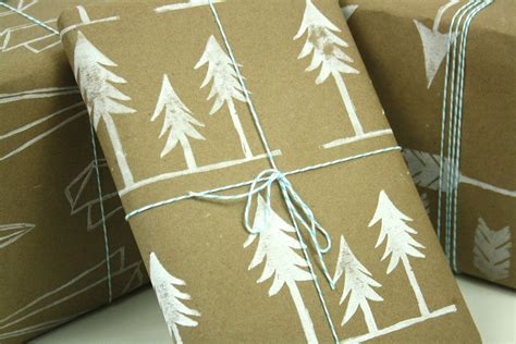 the simple wintry handprinted pine trees wrapping paper