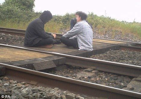 kent teens filmed lying on train tracks | daily mail online