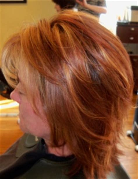 100 gray client wants highlights red hair with brown lowlights and blonde highlights