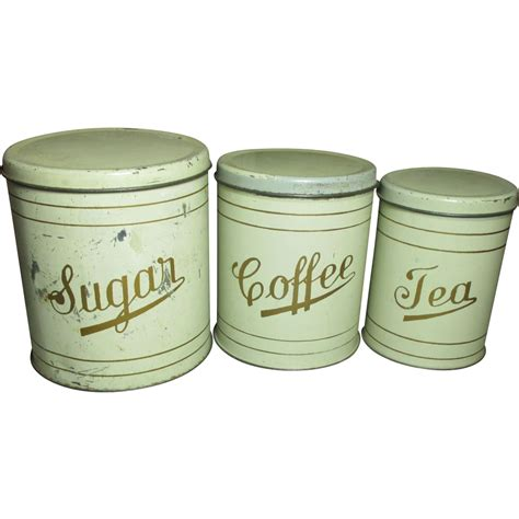 great old set of farmhouse kitchen metal canisters from rubylane sold on ruby lane