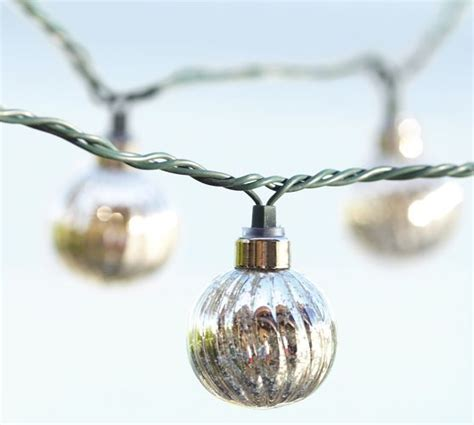 mercury glass globes with lights hmm maybe diy use silver spray paint mercury glass
