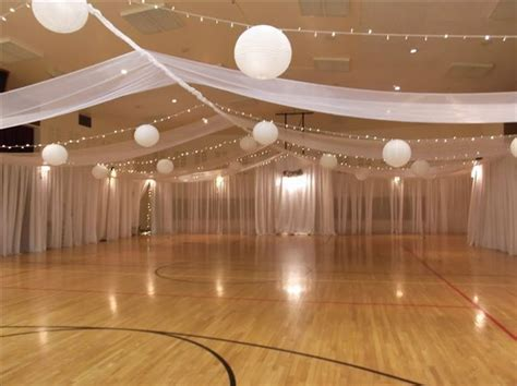 Simple draping of lights and linens incorporating the