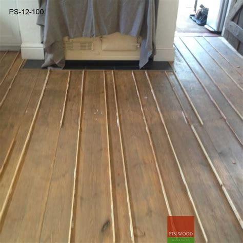 Pine slivers   gap filling floor boards