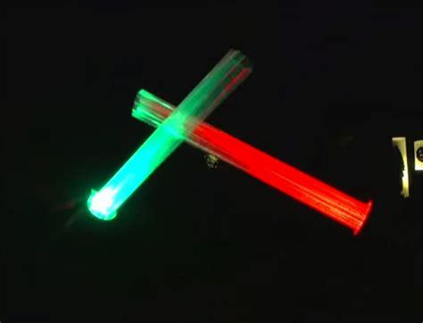 guy makes giant lightsabers for his christmas display