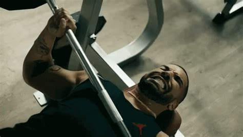drake bench press drake fails his bench press miserably in funny apple music advertisement