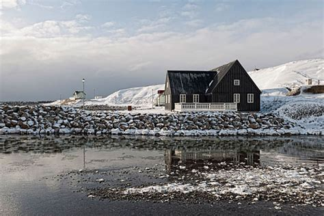 buy house in iceland photograph of black house hafsos iceland photography