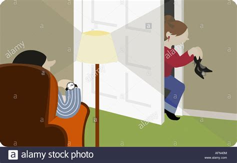 buying house with girlfriend girl sneaking into her house with her father waiting for her stock photo royalty free