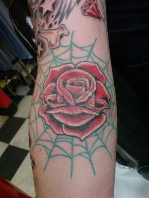rose on elbow tattoo meaning images designs