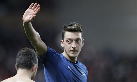 arsenals mesut oezil faces questions  night