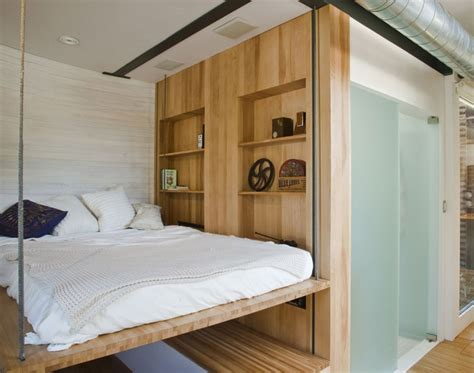 beds that hang from the ceiling retractable bed rises up to the ceiling small houses