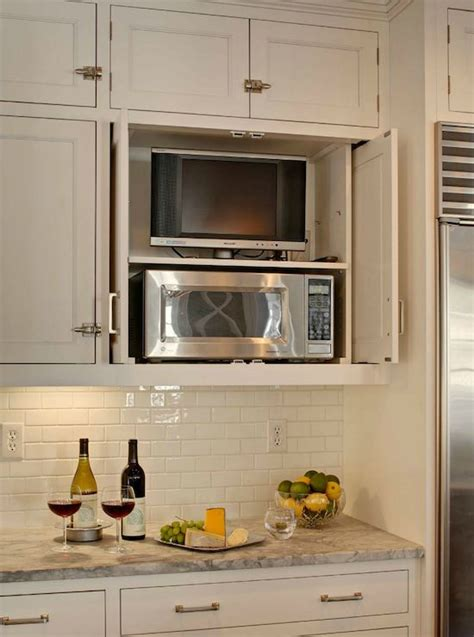 heidi piron design clever way to hide tv in kitchen i