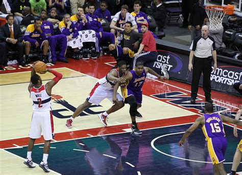 john wall bench press file john wall attempts free throw lakers bench in