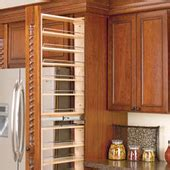 upper cabinet pull down shelf pulldown shelves offer a new way to find order in the
