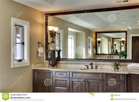 large mirror in bathroom bathroom with large mirror royalty free stock image