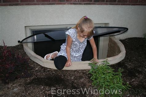 finish a basement apartment safely with egress window wells