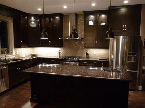 dark kitchen cabinets with dark countertops kitchens with black cabinets black glass tile backsplash