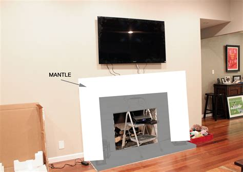 tv above fireplace where to put cable box tv above fireplace paint design