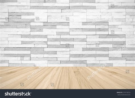 white grey colour brick tile textured wall with wood floor in light yellow color tone