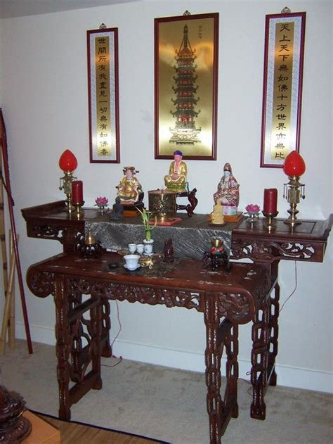 lovely buddhist home altar with beautiful rosewood or