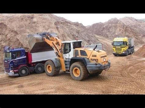 liebherr l580 2plus2 wheelloader loading scania trucks phim video clip