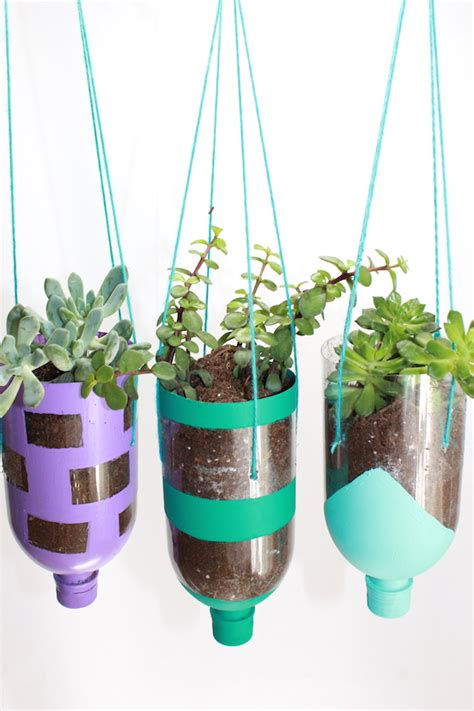 recycled water bottle crafts for how to make hanging planters from recycled water bottles