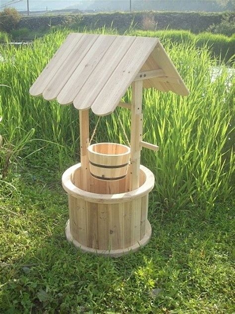 Well Planter by Wishing Well Planters Outdoor Wishing By Dalian