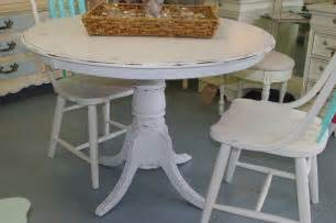 This adorable dining table has been distressed and would fit in any