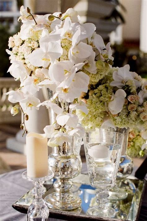 Gorgeous Mercury Glass Vases With White Flower Bouquets On Mirror Centerpieces Ideas