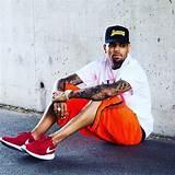 "Chris Brown wearing the Nike Roshe One ""Crimson"""