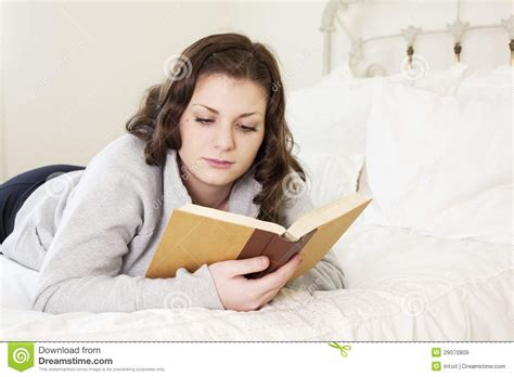 reading in bed girl reading in bed royalty free stock images image
